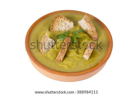 clay plate with soup and vegetable soup isolated - stock photo