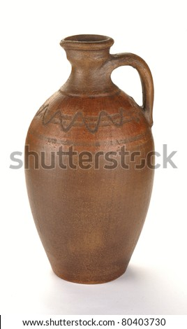 Clay pot of manual work. It is possible to store milk or other liquid - stock photo