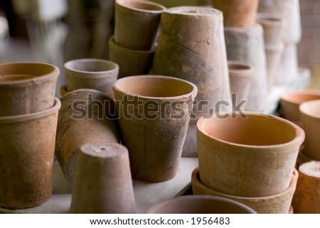 Clay pot pile, shallow DOF - stock photo