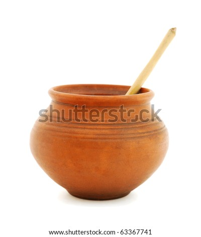 Clay pot with wooden spoon on white background
