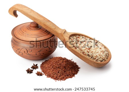 clay pot, wooden spoon and wild rice with star anise isolated on white background