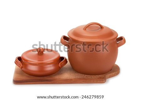 clay pots and cutting board isolated on white background - stock photo