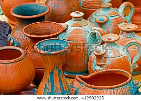 Clay pots of various shapes, sizes and ages. - stock photo