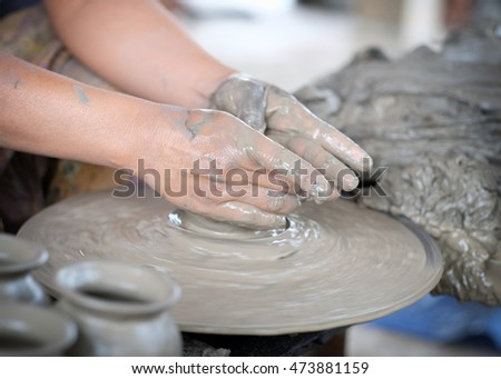 Clay potter,Working on pottery wheel,Thailand.