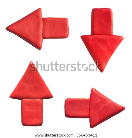 Clay putty, plasticine handmade dimensional arrow icons set. Putty design different directions arrows isolated on white background. - stock photo