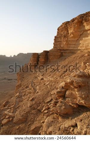 Clay rocks surrounding Riyadh city at sunset (Saudi Arabia) - stock photo