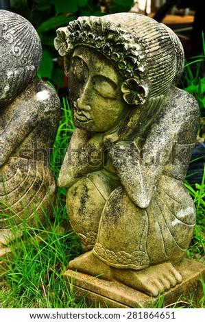 Clay sculpture garden art Thailand stature cute doll. - stock photo