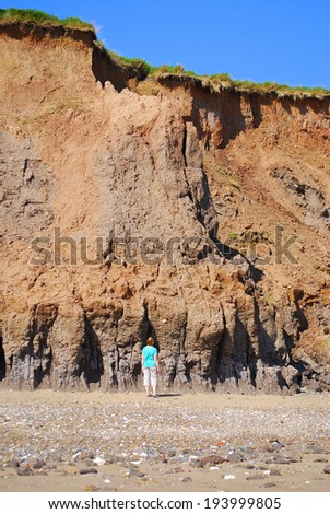 Clay sea cliff erosion, Hornsea, East Yorkshire, UK  - stock photo