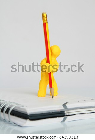 Clay statues of men write project - stock photo