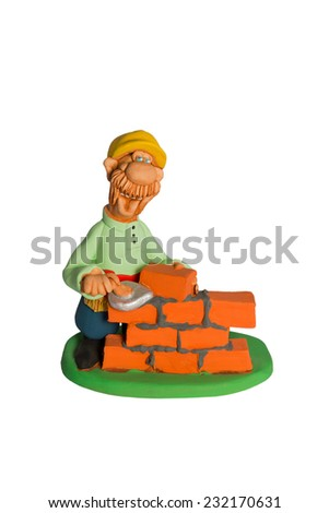 Clay statuette cheerful a bricklayer with a mustache who lays masonry isolated on white background - stock photo