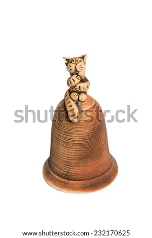 Clay statuettes a cat sitting on top of the bell isolated on a white background - stock photo