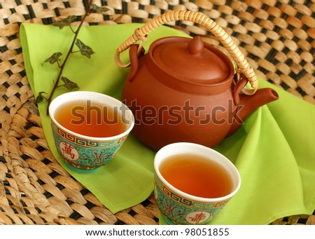 clay teapot and cups of tea - stock photo
