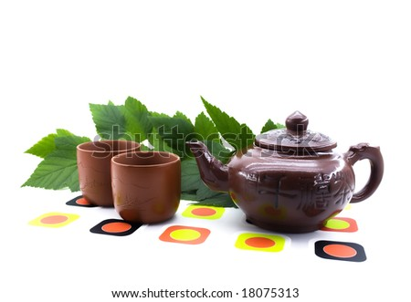 Clay teapots and cups isolated on a white background