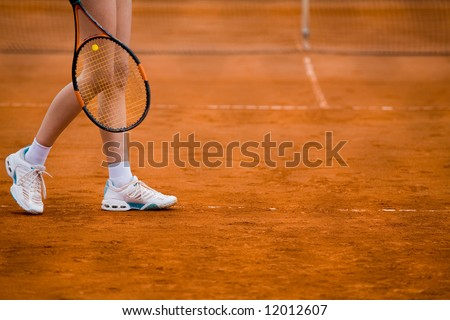 Clay tennis court with Tennis player legs - stock photo