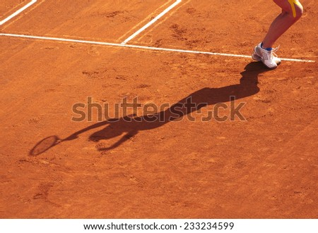 Clay tennis court with Tennis player legs. Roland Garros french open tournament - stock photo