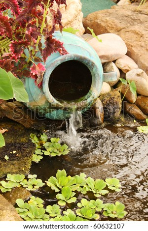 Clay water feature near a pond - stock photo