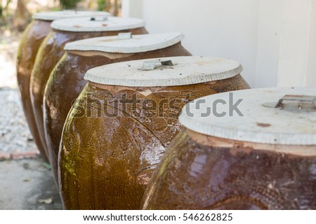 clay water storage pots at a house in vietnam