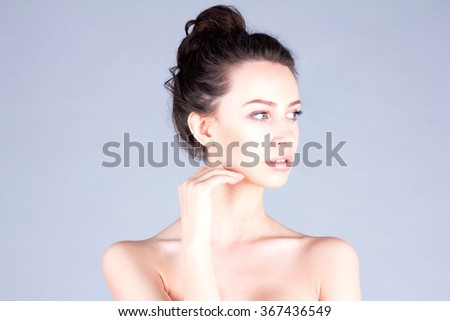 Clean and fresh face of woman. Beautiful woman with long neck touching cheek. Result  facial. - stock photo