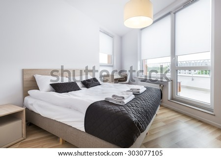 Clean and Modern Bedroom with empty wall in scandinavian style - stock photo
