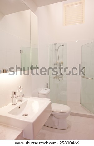 Clean and white color modern classy minimalistic bathroom toilet - stock photo