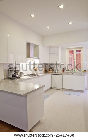 Clean and white color modern classy minimalistic kitchen - stock photo