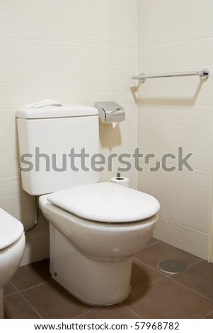 Clean and white watercloset in a bathroom - stock photo