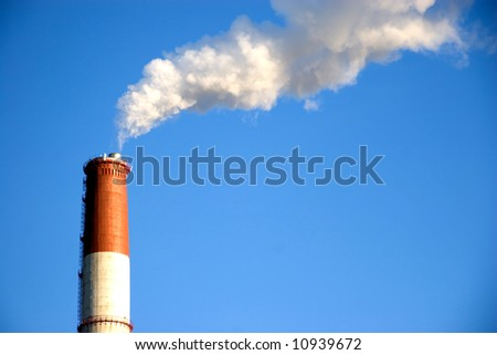 clean blue sky and exhaust white smoke - stock photo