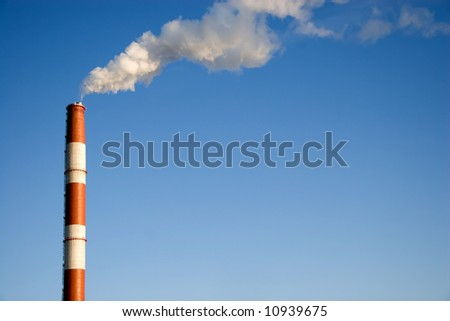 clean blue sky and exhaust white smoke