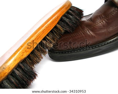 Clean brush and brown men shoe in isolated background - stock photo