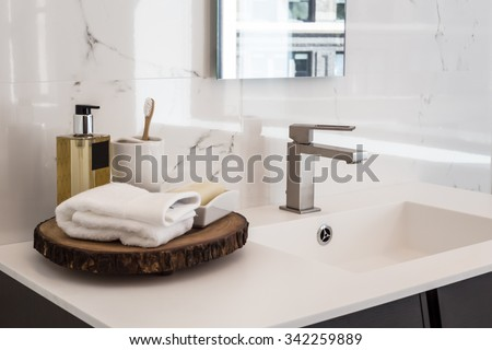 Clean contemporary bathroom sink - stock photo