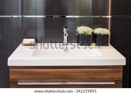Clean contemporary bathroom sink - stock photo