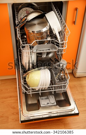 Clean dishes in dishwashing machine in closeup - stock photo