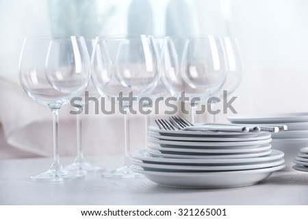 Clean dishes on the table - stock photo