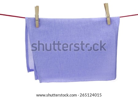 Clean Dry Violet Textured Towel Hanging On A Red Rope  Isolated On A White Background With Copy Space. You can use this image as signboard. - stock photo