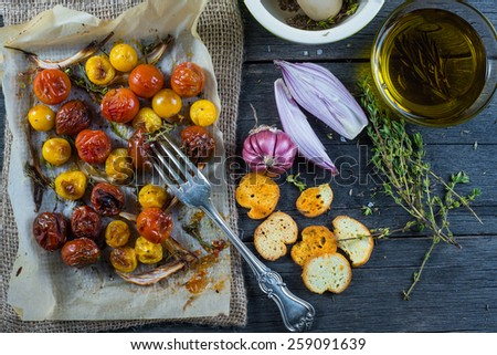 Clean eating,roasted tomato with herbs and olive oil - stock photo