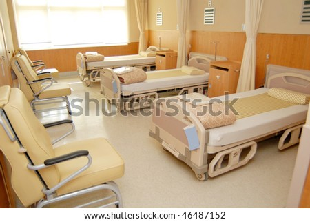 Clean empty beds in a hospital ward - stock photo