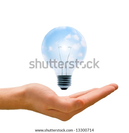 Clean energy, a light bulb with a bright sky held up by a hand. - stock photo
