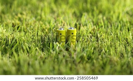 Clean energy conceptual image; blank batteries outdoor.