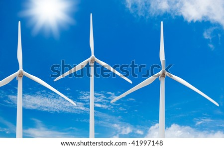Clean Energy, Windmills with Sun and Blue Sky - stock photo