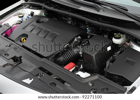 Clean engine bay of a brand new car - stock photo