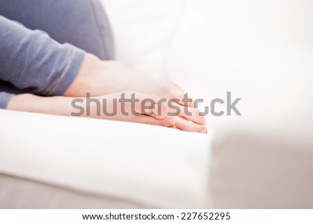 clean feet of a young woman sleeping on a white couch - stock photo