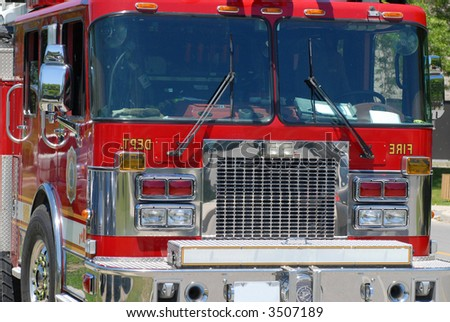 clean fire truck ready for an emergency response - stock photo