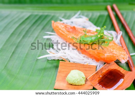 Clean food and good taste with fresh crab stick and sushi, japanese food put on banana leaf at the japan  restaurant with copy space,Focus on seaweed on crab