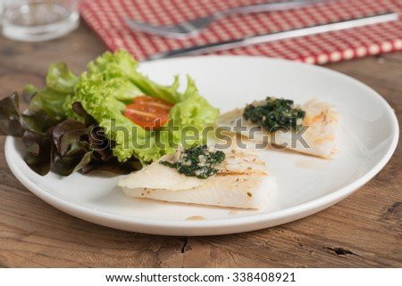 Clean food, Fish fillet with basil and garlic sauce.