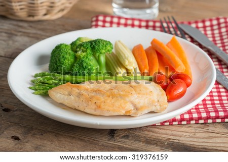 Clean food, Grilled chicken breasts and vegetables. - stock photo