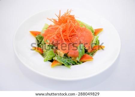 Clean food - Smoke salmon caesar on white plate - stock photo