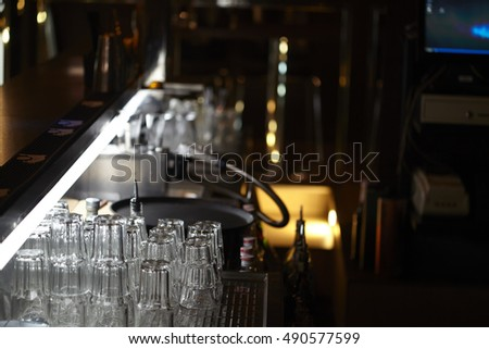 clean glasses behind the bar
