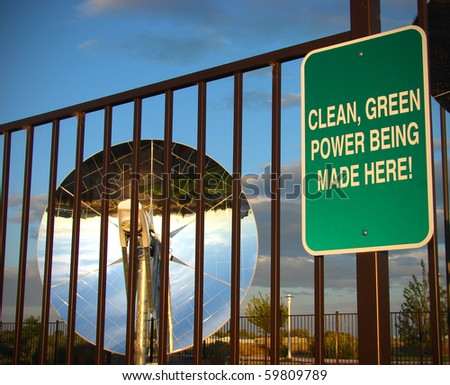 clean green powers sign with parabolic dish solar energy collector in background - stock photo