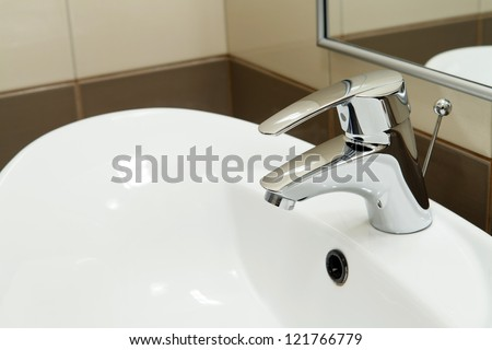 clean hotel bathroom sink and faucet - stock photo