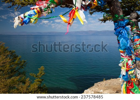 Clean lake Baikal and colorful traditional ribbons - stock photo